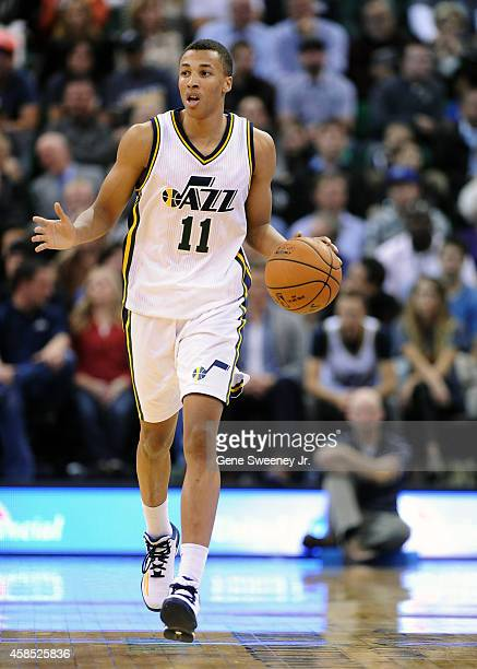 Dante Exum of the Utah Jazz brings the ball up court during their game against the Cleveland Cavaliers at EnergySolutions Arena on November 5 2014 in...