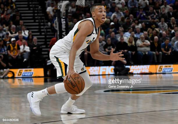 Dante Exum of the Utah Jazz dribbles the ball against the Golden State Warriors in the first half of a game at Vivint Smart Home Arena on April 10...