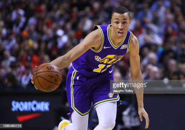 Dante Exum of the Utah Jazz dribbles the ball during the second half of an NBA game against the Toronto Raptors at Scotiabank Arena on January 1 2019...