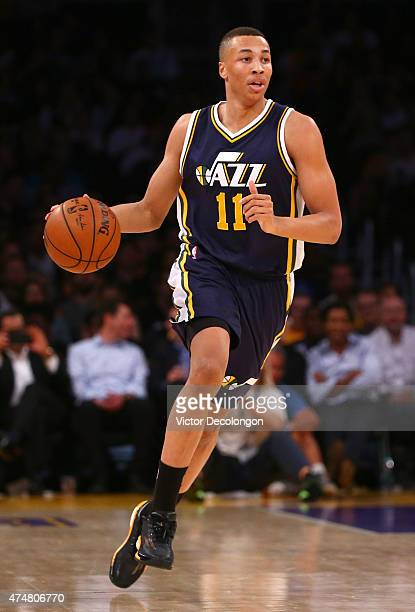 Dante Exum of the Utah Jazz dribbles the ball in the first half of the NBA game against the Los Angeles Lakers at Staples Center on March 19 2015 in...