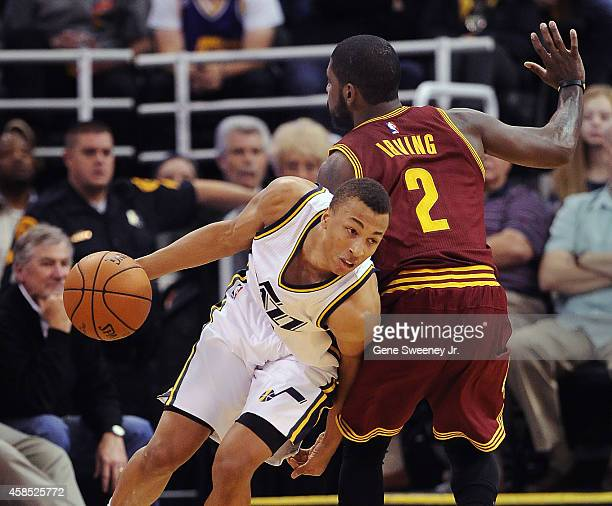 Dante Exum of the Utah Jazz drives around Kyrie Irving of the Cleveland Cavaliers during their game at EnergySolutions Arena on November 5 2014 in...