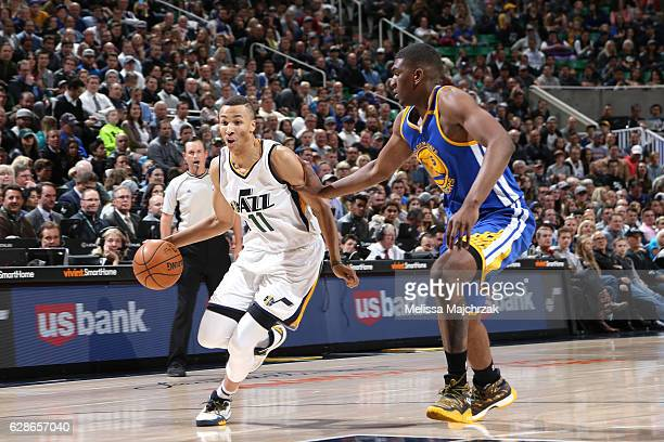 Dante Exum of the Utah Jazz drives to the basket against Kevon Looney of the Golden State Warriors during the game on December 8 2016 at...
