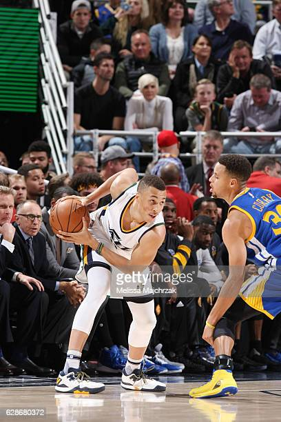 Dante Exum of the Utah Jazz drives to the basket against Stephen Curry of the Golden State Warriors during the game on December 8 2016 at...