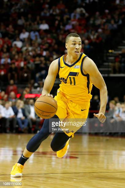 Dante Exum of the Utah Jazz drives to the basket in the first half against the Houston Rockets at Toyota Center on December 17 2018 in Houston Texas...