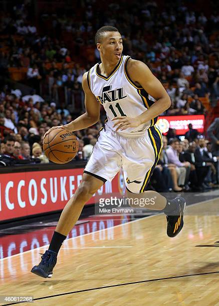 Dante Exum of the Utah Jazz drives to the lane during a game against the Miami Heat at American Airlines Arena on December 17 2014 in Miami Florida...