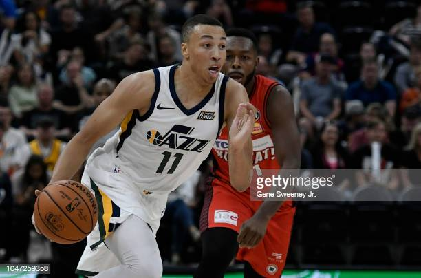 Dante Exum of the Utah Jazz drives with the ball in a preseason game against the Perth Wildcats at Vivint Smart Home Arena on September 29 2018 in...
