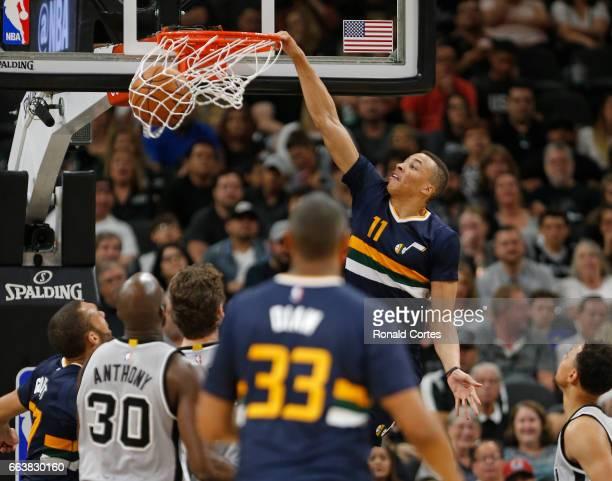 Dante Exum of the Utah Jazz dunks over the San Antonio Spurs at ATT Center on April 2 2017 in San Antonio Texas NOTE TO USER User expressly...