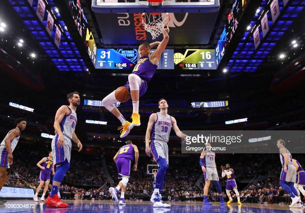 Dante Exum of the Utah Jazz dunks past Jon Leuer of the Detroit Pistons during the first half at Little Caesars Arena on January 05 2019 in Detroit...