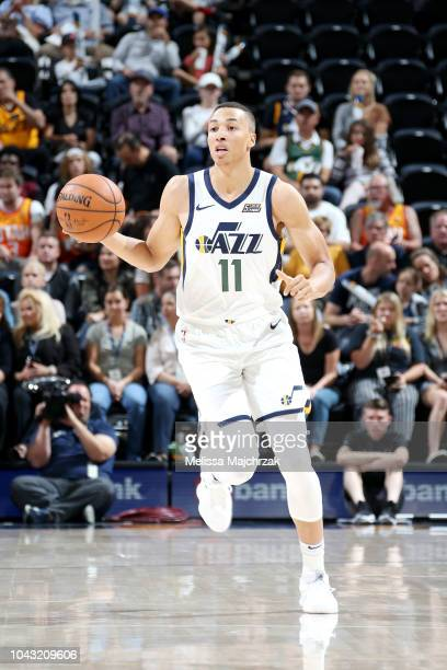 Dante Exum of the Utah Jazz handles the ball against the Perth Wildcats during a preseason game on September 29 2018 at Vivint Smart Home Arena in...