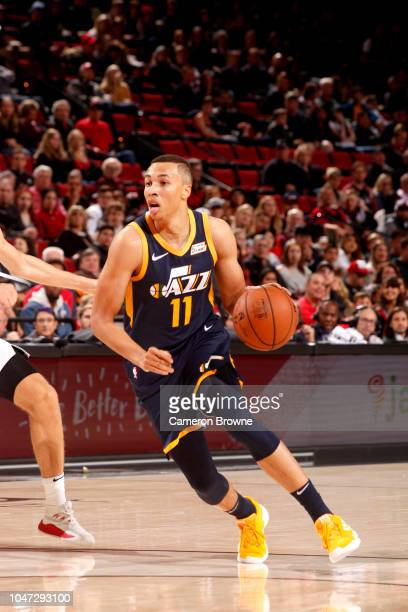Dante Exum of the Utah Jazz handles the ball against the Portland Trail Blazers during a preseason game on October 7 2018 at the Moda Center in...