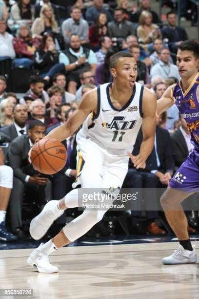 Dante Exum of the Utah Jazz handles the ball against the Sydney Kings during a preseason game on October 2 2017 at vivintSmartHome Arena in Salt Lake...