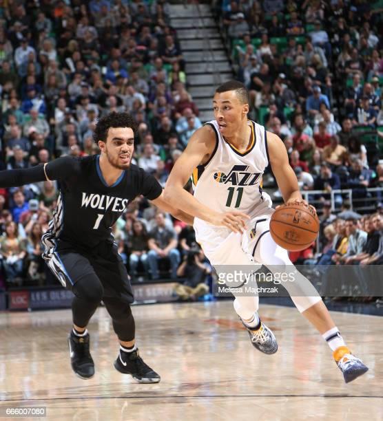 Dante Exum of the Utah Jazz handles the ball against Tyus Jones of the Minnesota Timberwolves during the game on April 7 2017 at vivintSmartHome...