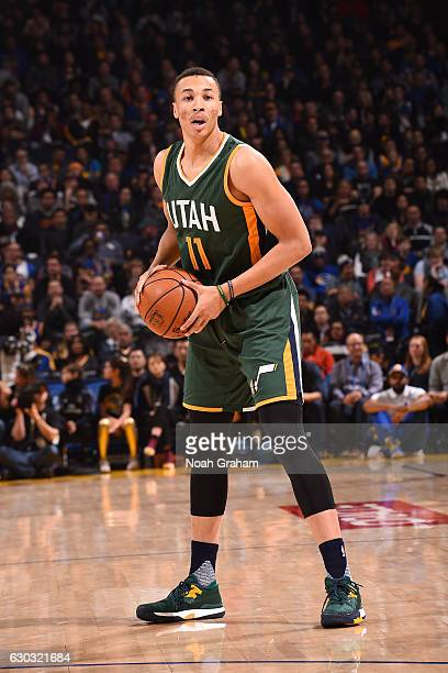 Dante Exum of the Utah Jazz looks to pass against the Golden State Warriors on December 20 2016 at ORACLE Arena in Oakland California NOTE TO USER...