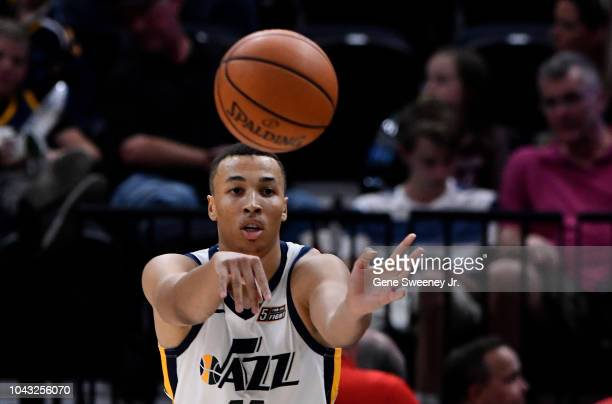 Dante Exum of the Utah Jazz passes the ball in the second half of a preseason game against the Perth Wildcats at Vivint Smart Home Arena on September...