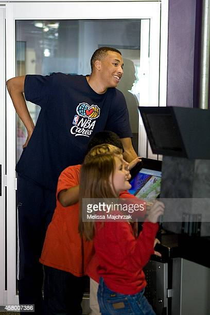 Dante Exum of the Utah Jazz plays with kids from Jackson Elementary School during their field trip to Discovery Gateway Children's Museum on October...
