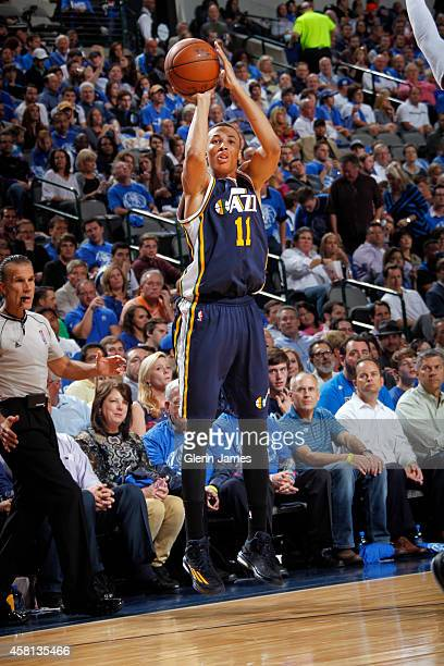 Dante Exum of the Utah Jazz shoots a jumper against the Dallas Mavericks on October 30 2014 at the American Airlines Center in Dallas Texas NOTE TO...