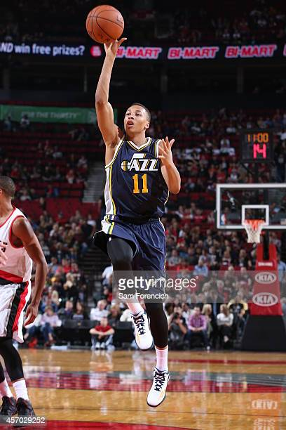 Dante Exum of the Utah Jazz shoots against the Portland Trail Blazers on October 9 2014 at the Moda Center Arena in Portland Oregon NOTE TO USER User...