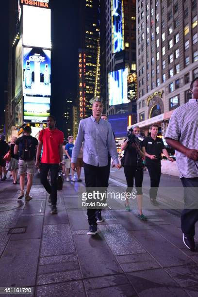 Dante Exum walks through Times Square prior to the 2014 NBA Draft on June 23 2014 in New York City New York NOTE TO USER User expressly acknowledges...