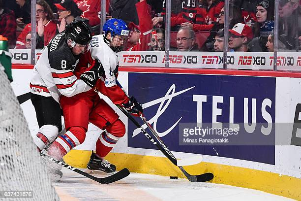 Dante Fabbro of Team Canada battles for the puck with Martin Necas of Team Czech Republic during the 2017 IIHF World Junior Championship quarterfinal...