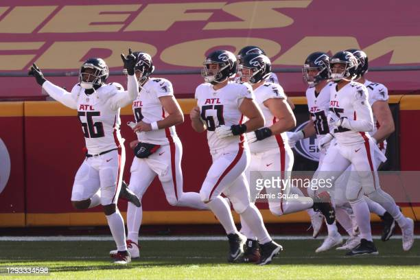 Dante Fowler Jr. #56 of the Atlanta Falcons runs on to the field with his teammates before the game against the Kansas City Chiefs at Arrowhead...