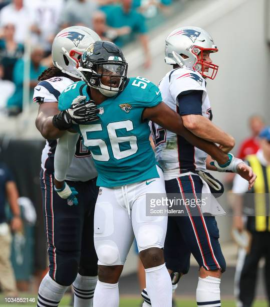 Dante Fowler Jr #56 of the Jacksonville Jaguars reacts to a play next to Tom Brady of the New England Patriots during the second half at TIAA Bank...