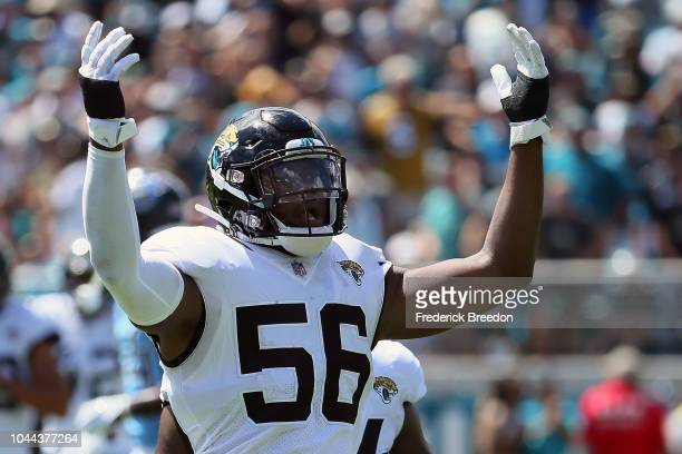 Dante Fowler Jr #56 of the Jacksonville Jaguars tries to rally the crowd against the Tennessee Titans at TIAA Bank Field on September 23 2018 in...