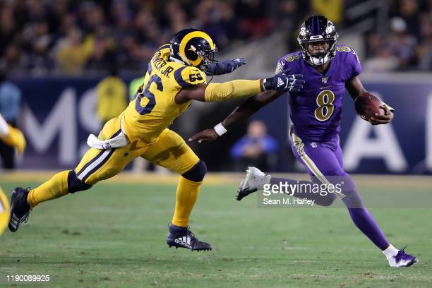 Dante Fowler Jr. #56 of the Los Angeles Rams chases Lamar Jackson of the Baltimore Ravens during the second half of a game at Los Angeles Memorial...
