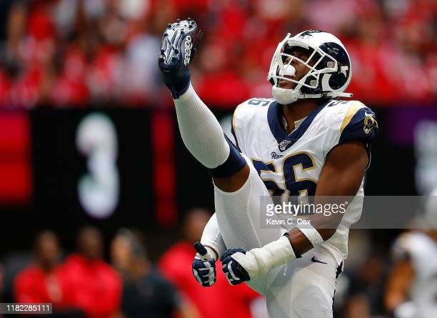 Dante Fowler Jr. #56 of the Los Angeles Rams reacts after sacking Matt Ryan of the Atlanta Falcons in the first half at Mercedes-Benz Stadium on...