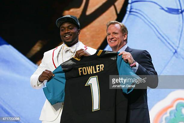 Dante Fowler Jr. Of the Florida Gators holds up a jersey with NFL Commissioner Roger Goodell after being chosen overall by the Jacksonville Jaguars...