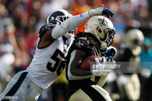Dante Fowler of the Los Angeles Rams attempts to tackle Alvin Kamara of the New Orleans Saints during the second half in the game at Los Angeles...