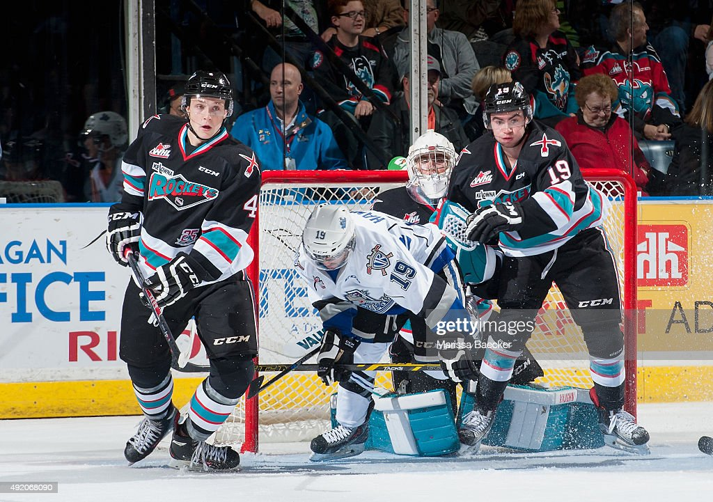 Dante Hannoun #19 of Victoria Royals gets tripped up by Dillon Dube #19, Jackson Whistle #1 and Gordie Ballhorn #4 of Kelowna Rockets on October 9, 2015 at Prospera Place in Kelowna, British Columbia, Canada.