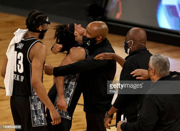 Dante Harris and Donald Carey of the Georgetown Hoyas celebrate the win with members of the coaching staff during the Quarterfinals of the Big East...