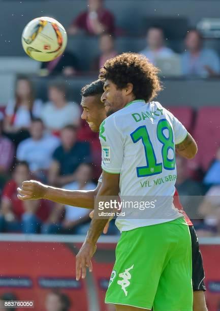 Dante im Kopfballduell mit Marvin Matip waehrend dem Fussball Bundesliga Spiel FC Ingolstadt gegen Vfl Wolfsburg am 4 Spieltag der Saison 2015/2016...