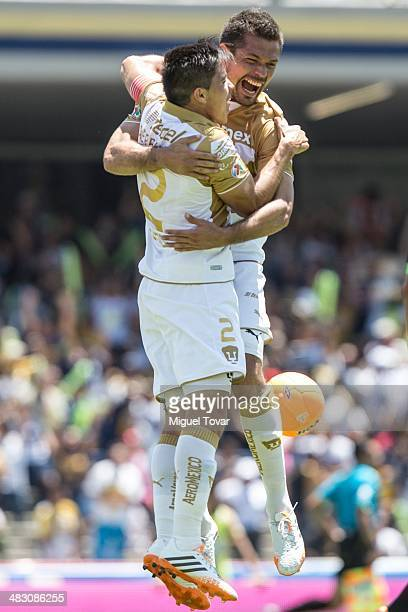 Dante Lopez of Pumas celebrates with Efrain Velarde after scoring his second goal during a match between Pumas UNAM and Chiapas as part of the 14th...