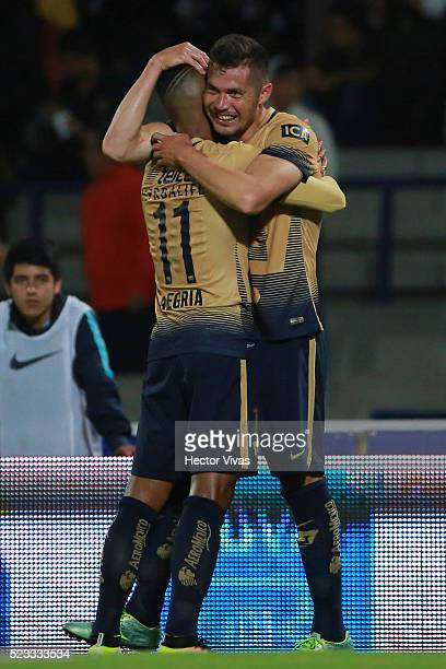 Dante Lopez of Pumas celebrates with teammates after scoring the first goal of his team during the 15th round match between Pumas UNAM and Tijuana as...