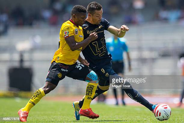 Dante Lopez of Pumas fights for the ball with Jonathan Gonzalez of Leones during a match between Pumas UNAM and Leones Negros as part of 12th round...