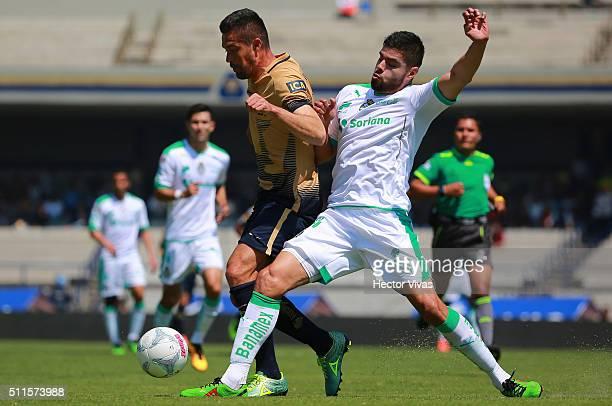 Dante Lopez of Pumas struggles for the ball with Nestor Araujo of Santos Laguna during the 7th round match between Pumas UNAM and Santos Laguna as...