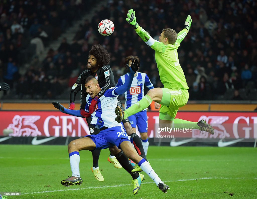 Dante of Bayern Muenchen and John Anthony Brooks of Hertha BSC duel during the game between Hertha BSC and Bayern Muenchen on November 29, 2014 in Berlin, Germany.