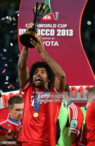 Dante of Bayern Munchen lifts the trophy after the FIFA Club World Cup Final match between FC Bayern Munchen and Raja Casablanca at the Marrakech...