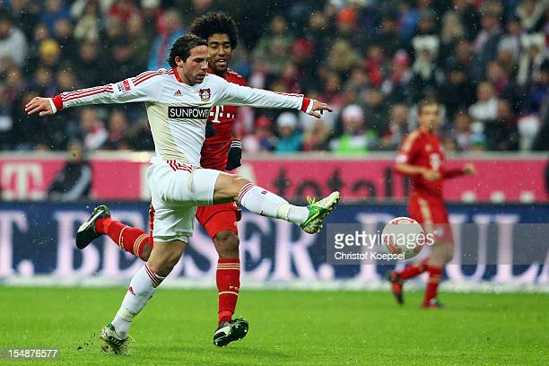 Dante of Bayernn challenges Gonzalo Castro of Leverkusen during the Bundesliga match between FC Bayern Muenchen and Bayer 04 Leverkusen at Allianz...