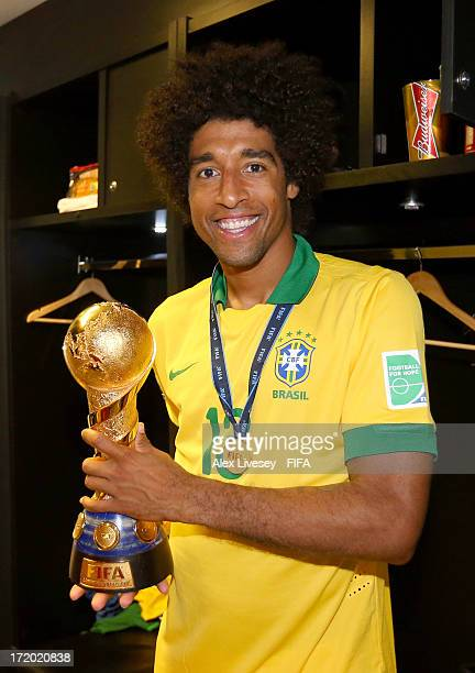 Dante of Brazil poses with the FIFA Confederations Cup trophy after the FIFA Confederations Cup Brazil 2013 Final match between Brazil and Spain at...