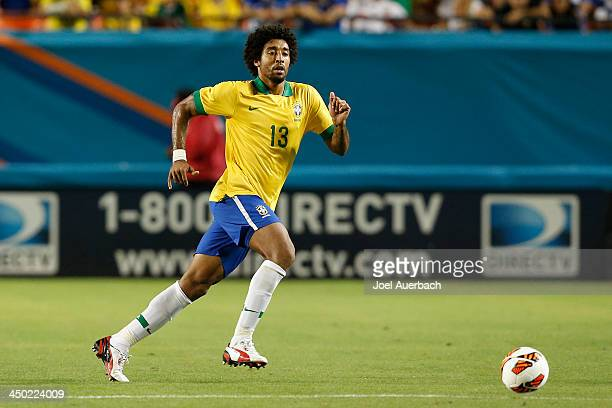 Dante of Brazil runs upfield during second half action against Honduras on November 16 2013 during a friendly match at SunLife Stadium Stadium in...