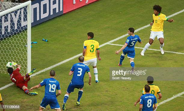 Dante of Brazil scores his team's first goal during the FIFA Confederations Cup Brazil 2013 Group A match between Italy and Brazil at Estadio Octavio...