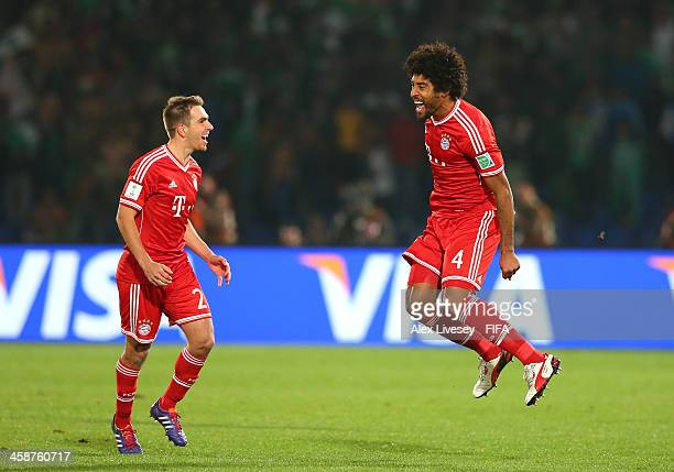 Dante of FC Bayern Munchen celebrates with Philipp Lahm after scoring the opening goal during the FIFA Club World Cup Final between FC Bayern Munchen...