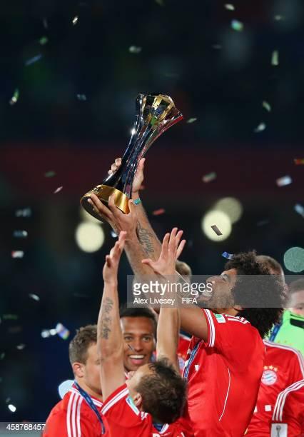 Dante of FC Bayern Munchen lifts the FIFA Club World Cup after victory in the FIFA Club World Cup Final between FC Bayern Munchen and Raja Casablanca...