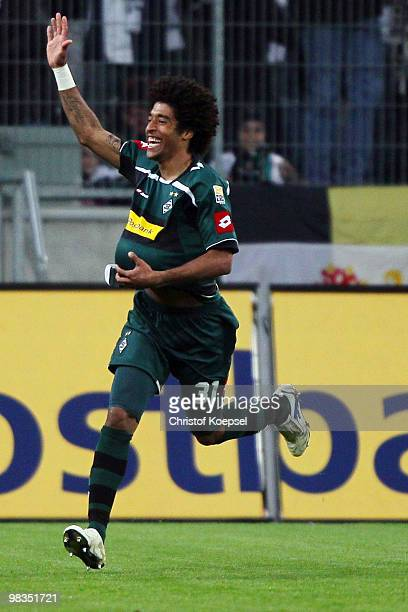 Dante of Gladbach celebrates after scoring his team's second goal during the Bundesliga match between Borussia Moenchengladbach and Eintracht...