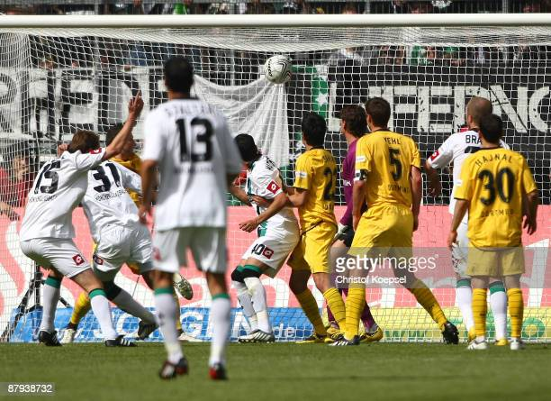 Dante of Gladbach scores the first goal during the Bundesliga match between Borussia Moenchengladbach and Borussia Dortmund at the Borussia Park on...
