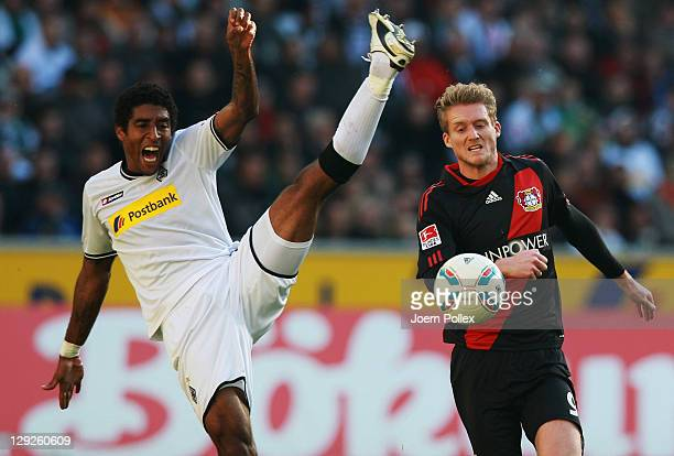 Dante of Moenchengladbach and Andre Schuerrle of Leverkusen battle for the ball during the Bundesliga match between Borussia Moenchengladbach and...