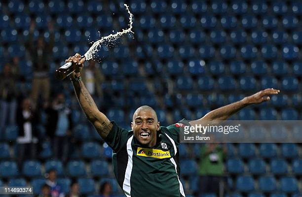 Dante of Moenchengladbach celebrates after getting a hair cut after the Bundesliga play off second leg match between VfL Bochum and Borussia...