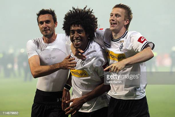 Dante of Moenchengladbach celebrates with team mates Martin Stranzl and MArco Reus after the Bundesliga play off second leg match between VfL Bochum...